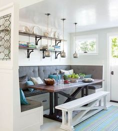Banquette seating is usually custom built and installed, but I have seen MANY people use the Expedit Shelving Unit from Ikea as a seat. Add some small furniture legs for height, some cushions to sit on, and some Expedit door inserts. Via flemarie.fr.