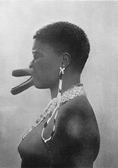 'Artificial Deformation - All the women of the Sara tribe have this artificial deformation of the lips as a sign of beauty. The effect is produced by piercing the lips and gradually enlarging the holes by inserting wooden discs, the size of which is increased as the lips get distended