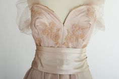 'Pink Ice', (Detail) - Sybil Connolly Evening dress of pink satin with overlay skirt of Carrickmacross appliqué lace decorated with butterfly motifs and tiny pearls. For the first time, the lace was made in a colour rather than the traditional white. Future Fashion, Pink Satin, Overlays, Evening Dresses, Butterfly, Ice, Colour, Traditional, Pearls