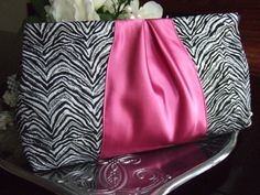 Another clutch perfect for prom: Ribbon Clutch in Metallic Zebra Print Brocade and Hot Pink Satin by surlefeu, $30.00