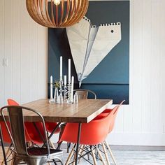 Under the dining room's pendant lamp, tomato-red fiberglass armchairs and a pair of metal Tolix chairs from DWR surround Dylan table. Art from Stephanie Breitbard Fine Arts and a rug from Restoration Hardware round out the design scheme. Decor, Modern Dining, Interior, Dining Room Walls, Modern Dining Room, Minimalist Living Room, Home Decor, Contemporary Decor Living Room, Tolix Chair