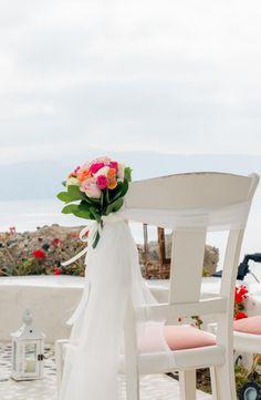 Santorini wedding-wedding - chair decorations - ceremony aisle