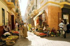 Vendors hawk their wares on a street in the old medina in Tangier, Morocco.