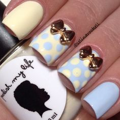 Pastel Yellow and Sky Blue Polka Dot Nails With Gold Bows.