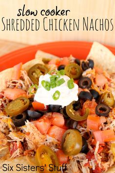 Slow Cooker Shredded Chicken Nachos from SixSistersStuff.com.  A tasty recipe perfect for a meal or an appetizer! #recipes #nachos #chicken