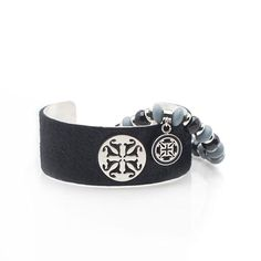"Our 1.0"" black calfskin is overlaid on a signature Rustic Cuff silver cuff and paired with a color coordinating Susan beaded bracelet with RC enameled logo."
