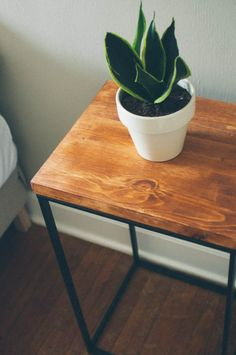 IKEA hack. Laundry basket frame and wood top makes for a nice side table. DIY side table inspiration.