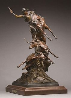 I  have a love of bronzes. This one has so much motion and detail.     Dodge City by Dustin Paine