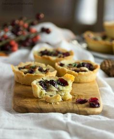 Savory bacon cranberry cheese tartlets are a low carb gluten free appetizer with bacon, cranberries, and melted Mahon Menorca cheese in a grain free crust.