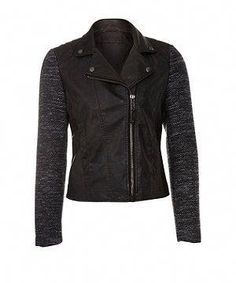 66a0f58f3ef4b A juxtaposition of edgy and twee this black PU leather look biker jacket  features boucle sleeves