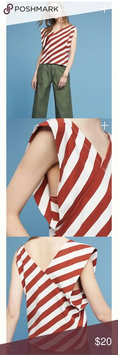 ANTHROPOLOGIE•NWT Dulcina Asymmetrical striped Top ✨NWT Anthropologie Dulcina Asymmetrical Striped Top!✨ •Brand New •Size S •Size is sold out online!  Asymmetrical red and white striped top! Has a v neckline in the front, and cuts to a v in the back as well! You can really tell it's a good, high quality top! What else would you except from Anthro? 😊  Don't like the price? Make me an offer with the button below! 👇🏻😊 Anthropologie Tops
