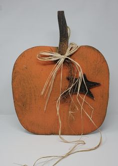 This ORANGE WOOD PUMPKINis MADE IN THE USA by a wonderful Artisan from PA ! The wood is cut in the shape of a LARGE PUMPKIN with a decorative STAR and RAFFIA RIBBON. This PUMPKIN would look great with your FRONT DOOR DECOR, on your MANTEL or FRONT PORCH. It will add such a festive FALL, HALLOWEEN and THANKSGIVING Rustic Nursery Decor, Rustic Fall Decor, Wood Pumpkins, White Pumpkins, Front Door Decor, Front Porch, Farmhouse Kitchen Signs, Farmhouse Decor, Fall Wood Signs