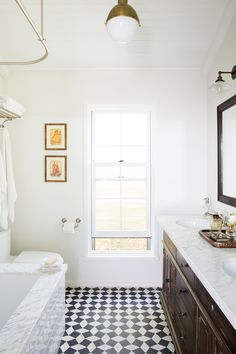 This black and white bathroom perfectly spans timeless and modern, with a touch of shabby chic farmhouse style.