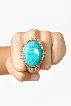"Studded Turquoise Ring. Although real turquise is a gemstone, it is difficult for anyone but a jeweler to tell the difference between gemstone quality turquoise & modern simulations. Therefore, most  ""turquoise"" jewelry will be found on this board."