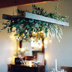 Creating this focal point above the table was so much fun. I bought large olive branches and worked to weave them in and out of the ladder rungs. I added in rosemary and silver eucalyptus for additional texture & scent! Hanging votives added a sweet glow that was reflected throughout the space ✨ Hope you enjoy this view! . . . Photography @sweetlifephoto.jake  Design & Styling @leelee_ree  Foliage Provided by @sammysflowers