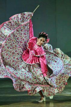 A Mexican folklorico dancer in full flight.