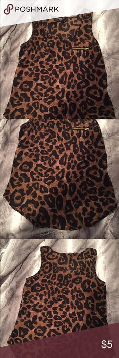 Ali + Kris Cheetah top Used but in perfect condition- zipper on front of shirt for design-                                                    Model is 5'10 and wears a size Small Tops Blouses