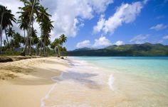 Rodeada de palmeras y vegetación, con aguas cristalinas y prácticamente desierta, playa Rincón es la... - Corbis. Texto: Redacción Traveler