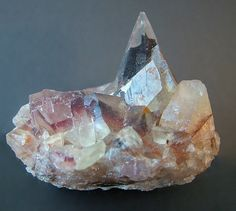 Aouli, Midelt Province, Drâa-Tafilalet Region, Morocco - A sharp, transparent scalenohedron with partial coating of an unknown mineral.