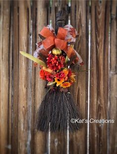 Don't get swept away with all the brilliant colors of Fall! This beautiful 24-inch long by 10-inch wide Broom is just the perfect decor for your kitchen, mantle or even on the front door. Filled with all the bountiful treasures of Fall from pinecones, acorns, mums, sunflowers, cat tails, and pomegranates, this is sure to welcome anyone into your home this season.