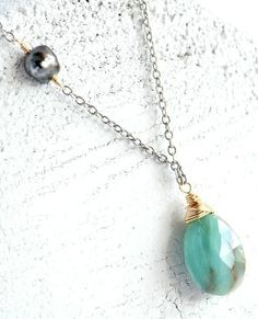 A Tahitian keshi pearl and Peruvian oval mixed metal necklace. By Kahili Creations of Hawaii