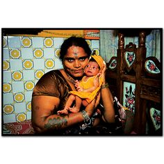 Pulabai, a madam, with the baby of one of her girls in the brothel.Falkland Road, Bombay, India. 1978 by Mary ellen Mark