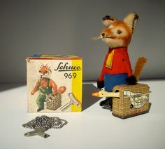Fox carrying goose wind-up toy. Schuco, Germany.