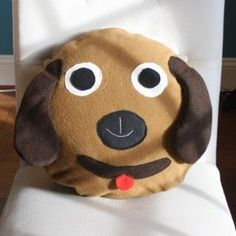 Handmade loveable Puppy Pillow, a must for dog lovers Floppy ears, loveable smile & red tongue, this handmade puppy pillow wins your heart. Made with care & love this charming handmade puppy pillow will be a favorite of kids & adults. This delightful puppy pillow adds charm to  Bedroom – In the middle of any bed for smiles every time Living room – On a special chair  This cuddly fleece this pillow never goes flat. Guaranteed. If you or someone you know loves puppies this pillow is a must…