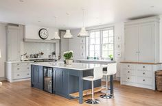 Timeless greys | Rencraft. A hand made kitchen painted in Farrow and Ball Pavilion Grey on the cabinetry and Railings on the island unit.