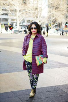 Electric colors mix with bold prints for major fashion week style #streetstyle #NYFW