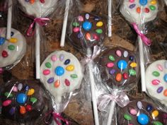 Daisy Scout Cake Pops - Chocolate and vanilla cake pops decorated with the daisy made from candy coated sunflower seeds and an M center.....its for the bridging ceremony from Daisy Scouts to Girl Scouts