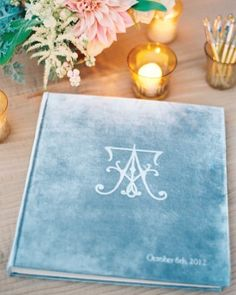 A custom guest book was covered in velvet and embossed with the pair's initials at this cream and ivory wedding in Virginia.