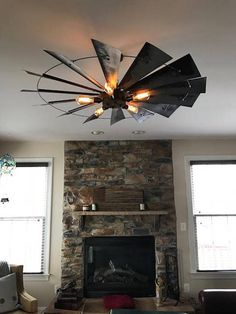 What Am & What Was I This rustic windmill makes the perfect hanging light fixture for a variety of spaces in your home. Made with sheet metal with an added steel housing to hide wiring and also holds the light sockets. The 30 and 38 models hold 3 light sockets. The 48 and the 60