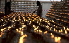 Hundreds of candles burn during Wesak Day celebrations at the Buddhist Maha Vihara temple in the Kuala Lumpur suburb of Brickfields in Malaysia