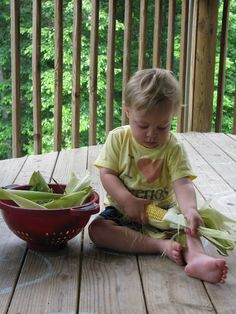 corn shuckin'.  They like to eat it since they helped get it ready for dinner.