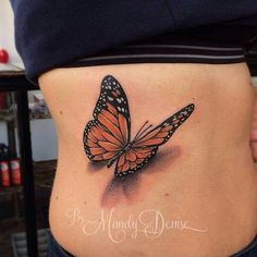 Incredible large Monarch butterfly tattoo by Mandy Denise