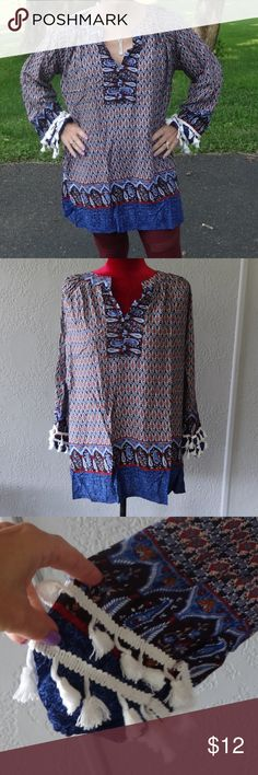 """NWT Meaneor Boho Hippy-Style Tunic Tassel Sleeves This fun, flowy tunic is by Meaneor and is new with the original tags still attached (it hasn't been steamed or pressed, thus the crease lines).  Made of 95% cotton, it is a size small, but has plenty of room....(I stand 4'11"""" tall and weight 105 pounds).  It is blue with tiny blue and red flowers throughout, and tassels on the bell sleeves--it measures 30"""" in length and 19"""" across the armpits.  Only worn for the photo. Meaneor Tops Tunics"""