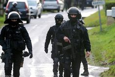 Manhunt: Searches were also taking place in a number of other villages in the north of France, with a road block in place in Corcy (above)