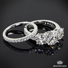 Featured here is a BREATHTAKING custom 3 stone pave Engagement Ring and a custom pave set Diamond Wedding Ring in Platinum by Whiteflash.com