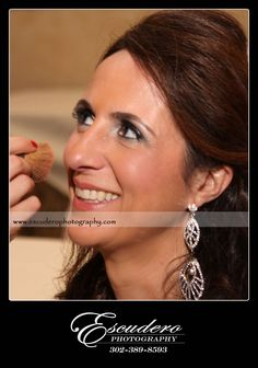 Bride having her makeup applied for her wedding at the Waterfall in Claymont, Delaware.