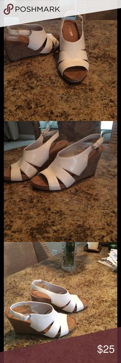 "✨AEROSOLES SANDALS EXCELLENT CONDITION ✨✨ Just in time for the warm weather! Aerosoles white sandals with 4 inch tan wedge heels! The sole is a ""sueded"" material adding to the softness of the ""plush pillow"" foot bed! Super comfy! In amazing condition as you can see by the photos! Worn a few times! AEROSOLES Shoes Sandals"