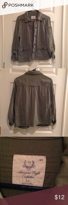 Army green button up Army green button up shirt. Looks super cute with a shirt underneath or buttoned up with jeans. American Eagle Outfitters Tops