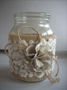 This listing is for a set of 4 hand-decorated jar. Decorated with burlap, lace and handmade flower fabric. They make a wonderful accent to your wedding whether its rustic, woodland, barn shabby, or vintage! This listing is for 4 jars . Rustic wedding decor, Lace and burlap mason jar, burlap centerpiece, country home decor.  dimensions: Height 5 or 12.5 cm #handmadehomedecor
