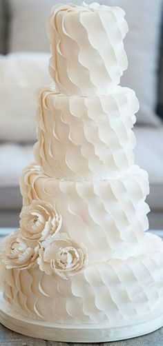 Wedding Cake - 'Diagonal Ruffle with Peonies' - The soft ruffles mimic the delicate layers of chiffon on a wedding dress.