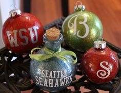 DIY Glitter Ornaments - this seems so randomly me! I love Christmas ornaments and definitely have done my share of DIYing them but when I saw these, I had to repin them. We are die hard WSU fans and the Hawks are our NFL team of choice! And, no - the other ornaments don't stand for bull shit!!!!! Ha, ha, ha, ha, snort..............