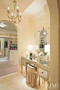 An Amy Howard dressing table is paired with hand-cut glasswork from Mirror Image in Los Angeles.