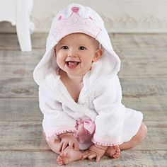 "Princess Spa Robe -  Adorably detailed soft white hooded terrycloth robe features organza-trimmed sleeves,a crown applique on the hood, tied with a pink satin ribbon.  Size is for 0-9 months. The robe measures 22"" h x 11"" w and can personalized with an initial at no extra charge Easy care and machine-washable $32.95"