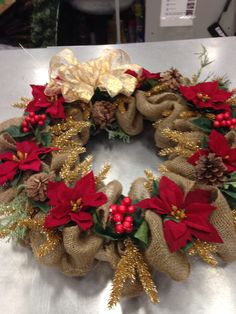 Christmas wreath.-love the burlap, red floral, and pine cones. Would change the gold and big bow.