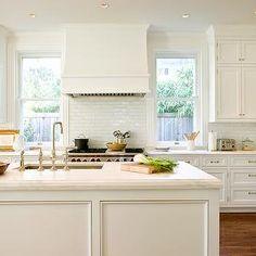 White, windows flanking range | Anne Decker Architects.