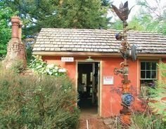 The Little Red Shed is a cozy cigar bar with a brick fireplace in the middle of a lush grove. Once the old poor farm's incinerator shed, it was totally hidden in foliage when the McMenamins purchased Edgefield in 1990.